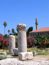 Antique greek columns and minaret of the mosque Royalty Free Stock Photo