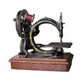 Antique hand cranked sewing machine isolated. Royalty Free Stock Image