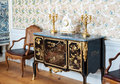 Antique interior chest of drawers clock and candlesticks in classic luxurious of rundale palace in latvia Royalty Free Stock Images