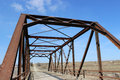 Antique iron bridge on gravel road in the country Royalty Free Stock Photo