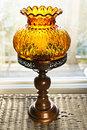 Antique lamp ornate amber glass and wood Stock Photos