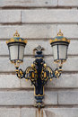 Antique lamp post ornate gilded at the royal palace in madrid spain Royalty Free Stock Images