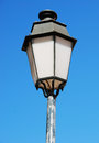 Antique lamp post vintage against a blue sky background lisbon Royalty Free Stock Image