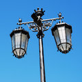 Antique lamp post vintage against a blue sky background lisbon Royalty Free Stock Photos