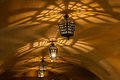 Antique lamps chandeliers in the cave dungeon Royalty Free Stock Photo