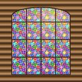 Antique large window with a multi-colored stained-glass window