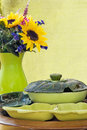 Antique lazy susan s with flower arrangement in background shallow definition of field Stock Images