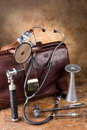 Antique medical instruments doctor s bag and such as stethoscope reflex hammer and head mirror Royalty Free Stock Photography