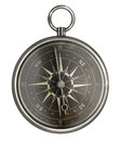 Antique metal compass with dark face isolated Royalty Free Stock Photo