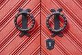 Antique metallic door knob on a red wooden doors Royalty Free Stock Photo