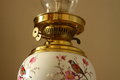 Antique oil lamp a photograph of an with bird decoration Royalty Free Stock Image
