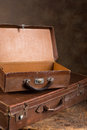 Antique open suitcases weathered old stacked with one and one closed Royalty Free Stock Photo