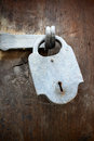 Antique padlock with hasp on a wooden door Stock Photography