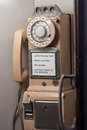 Antique pay phone vintage rotary in booth Royalty Free Stock Photo