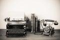 Antique phone and typewriter Royalty Free Stock Photo