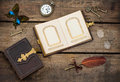 Antique photo album with butterfly over wooden background