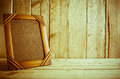 Antique photo frame on wooden table over wood background Royalty Free Stock Photo