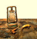 Antique pistol and powder horn with an old lantern on slate a beige background Stock Photography