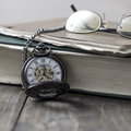 An antique pocket watch, glasses and bible Royalty Free Stock Photo