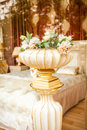 Antique porcelain vase with flowers at classic interior Royalty Free Stock Photo