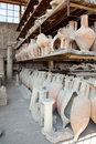 Antique pottery jugs at the ancient roman city of pompeii Stock Photo