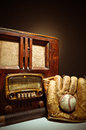 Antique radio with baseball mit and glove from the s an bat Stock Photo