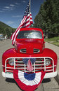 Antique red truck and us flag july independence day parade telluride colorado usa Stock Photos