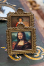 Antique reproduction of mona lisa portrait at flea market Stock Photos