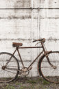 Antique or retro oxidized bicycle outside on a concrete wall vintage Royalty Free Stock Images