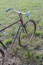 Antique or retro oxidized bicycle outside in the garden Stock Photo