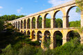 Antique roman aqueduct in tarragona spain Stock Image