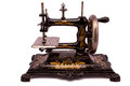 Antique sewing machine on white background Royalty Free Stock Photo