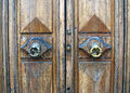 Antique shabby door with knobs round handles and lock Royalty Free Stock Images