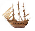 Antique ship as wooden model on white background Stock Images