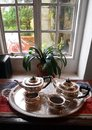 Antique silver tea service set by window a photograph showing a beautiful old english style serving displayed on a tray the old of Stock Photos