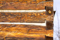 Antique square log cabin wall end Royalty Free Stock Images