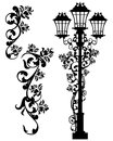 Antique street light among roses