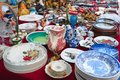 Antique stuff for sale in a flea market. Antiquities, vintage dishes Royalty Free Stock Photo