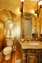 Antique style gold bathroom beautiful with washbasin cabinet and walls Royalty Free Stock Photos