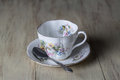 Antique Teacup with Silver Spoon Royalty Free Stock Photo