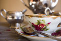 Antique teacup and silver tea set Royalty Free Stock Photo