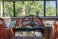 Antique tractor cab with steering wheel Royalty Free Stock Photo
