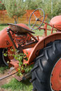 Antique tractor old rusty farm seat and wheel Stock Images