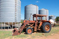 Antique Tractor and Silos Royalty Free Stock Photo
