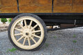 Antique truck wheel pickup with spokes below wood cargo bed panels Stock Photos
