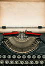 Antique typewriter with aged textured paper sheet Royalty Free Stock Photo