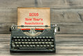 Antique typewriter with grungy paper. New Year Resolutions Royalty Free Stock Photo