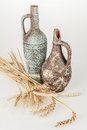 Antique vases with rye on white background Stock Photography