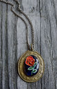 Antique vintage medallion on a wooden board Stock Photography