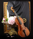 Antique violin, baguette, and bouquet Stock Photos